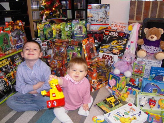 [Xmas 2009 - Tom and Emma with all their presents!]